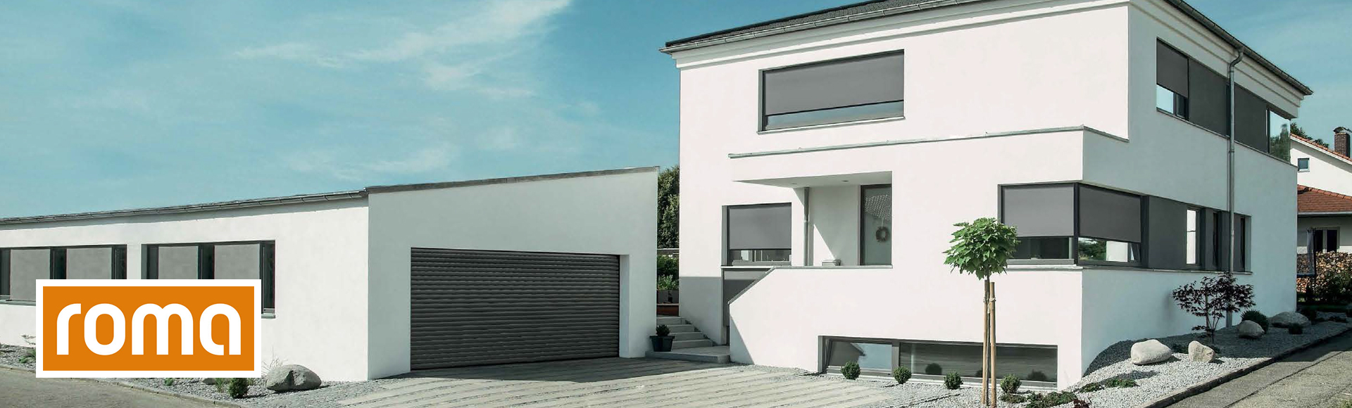 stunning residential facade featuring grey ROMA shading solutions.