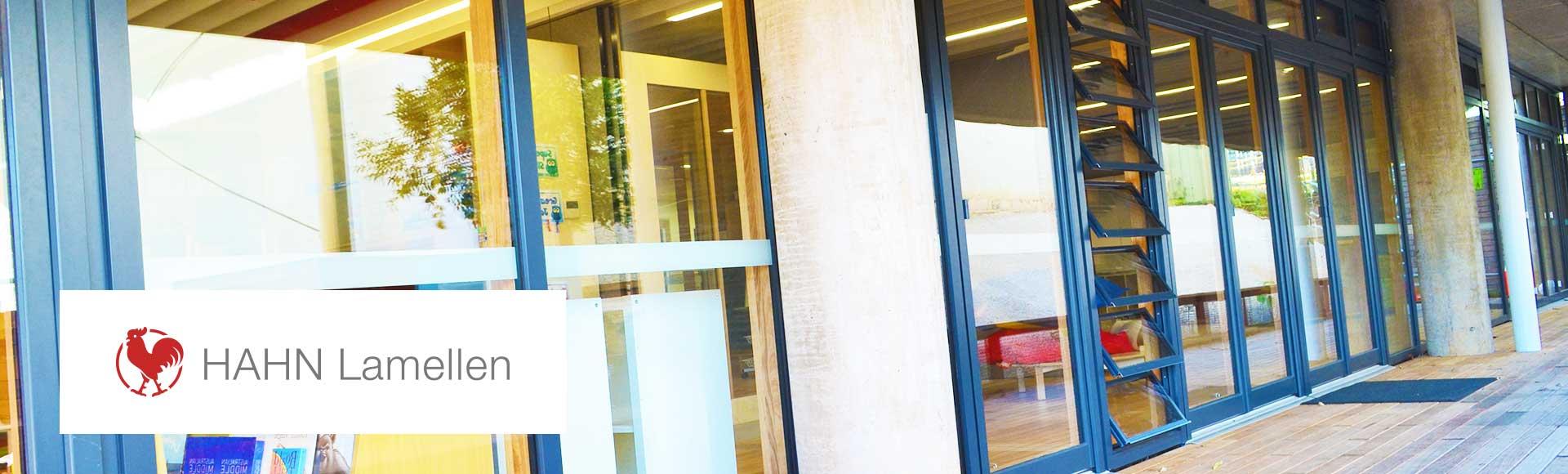 beautiful facade featuring HAHN louvre windows with deep blue aluminium frame